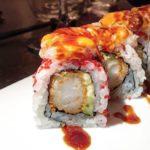 Uramaki riccio all'interno gambero in tempura,avocado, top di tartare di gambero pesce bianco, ricci